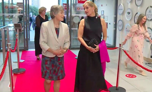 Roland Mouret Mulligan skirt. Countess of Wessex wore a layered midi skirt from Roland Mouret. Diamond earrings