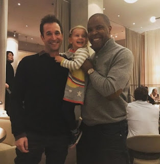 Picture of Eriq La Salle carrying kid along with his friend