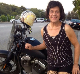 Richard Simmons posing for photo with a bike