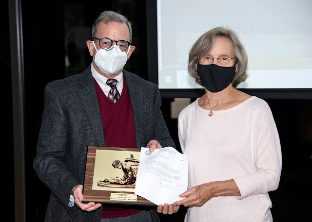 Dr. Patricia A. Deuster, director of USU's Consortium for Health and Military Performance, accepts the Distinguished Service Award at a town hall meeting Sept. 23, 2021.