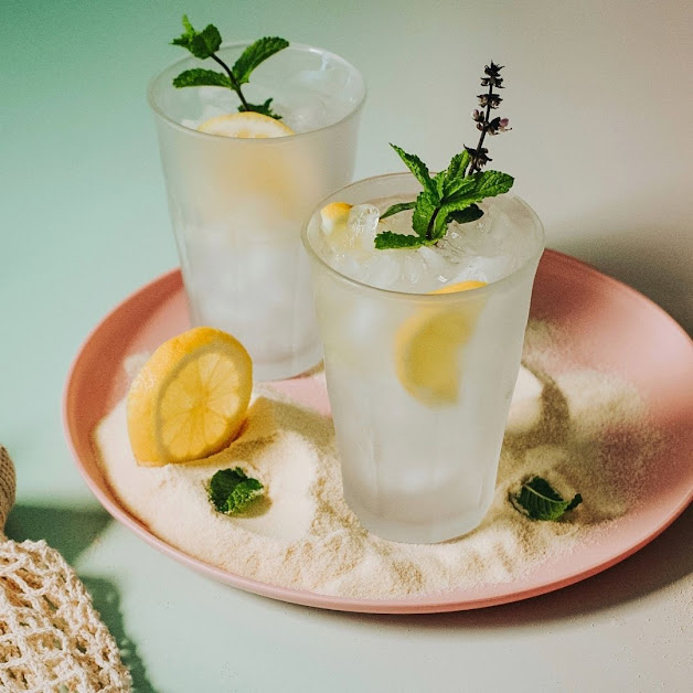 Thai Basil Cocktail on pink plate with lemon slice