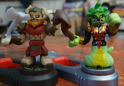 Akedo Ultimate Arcade Warriors Miss Slither and viking man close up