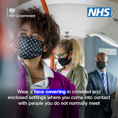 People on the bus wearing a face covering