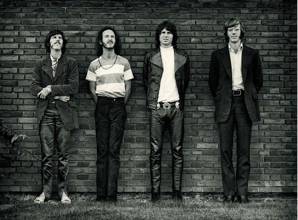 The Doors memebers standing. From left to right: Densmore, Krieger, Morrison and Manzarek